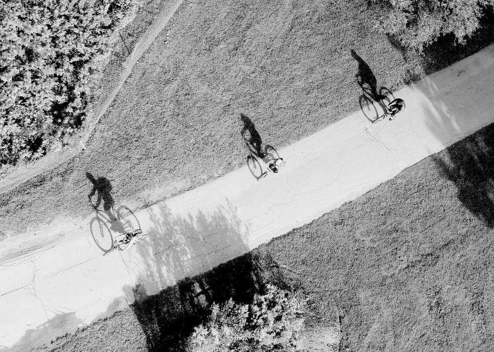 A piece of fine art art photography titled Family Cycling by Jian Wang