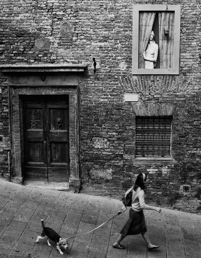 A piece of fine art art photography titled The Girl Watching In the Window by Massimo Valicchia
