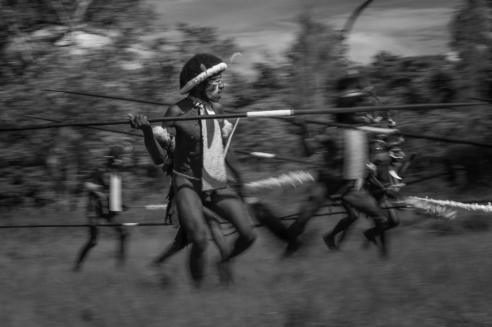 A piece of fine art art photography titled Inter-tribal Wars In the Baliem Valley by Ronni Santoso