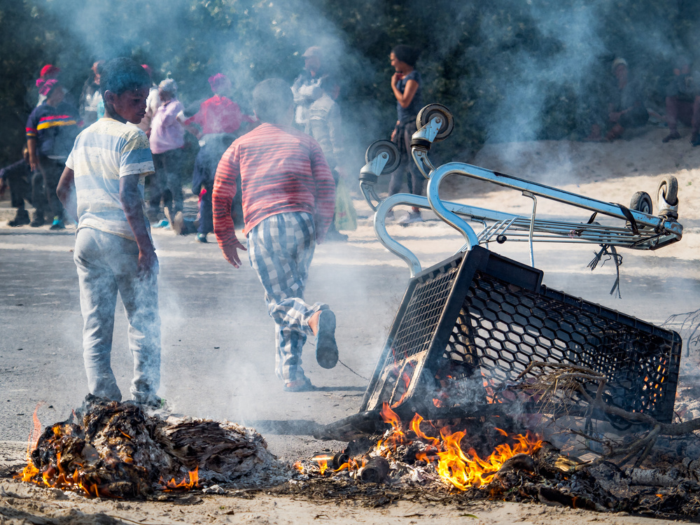 A piece of fine art art photography titled Hout Bay Protests by Giovanni Casini
