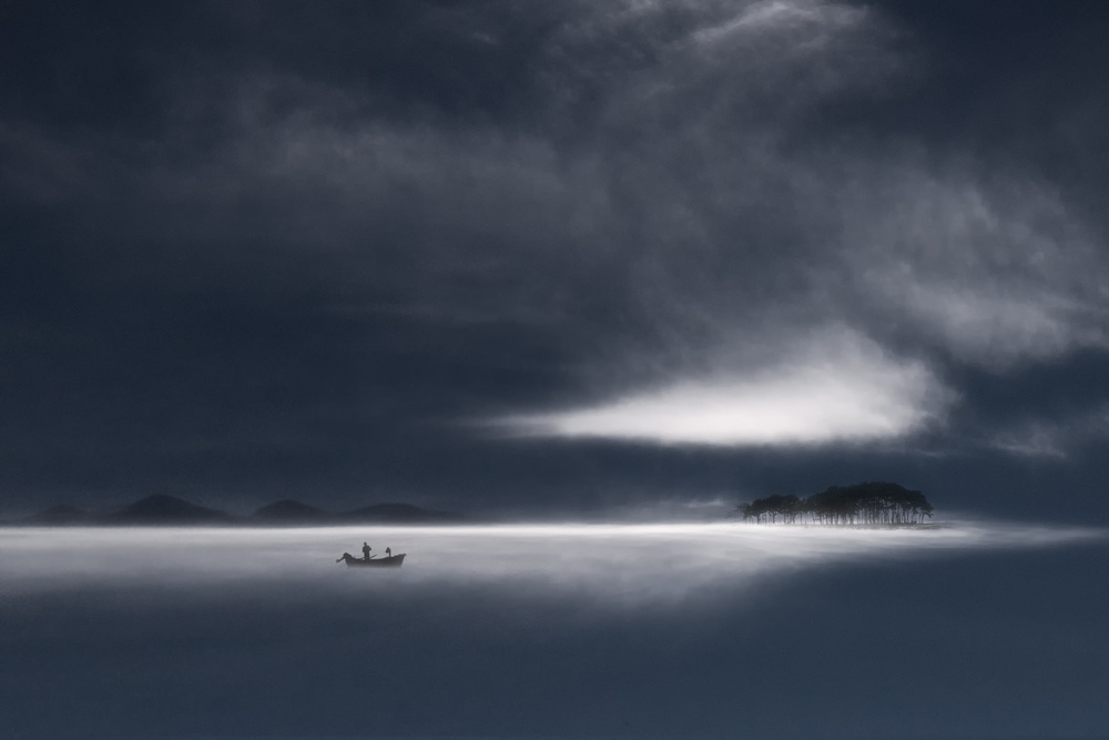 A piece of fine art art photography titled Fisherman by Uschi Hermann