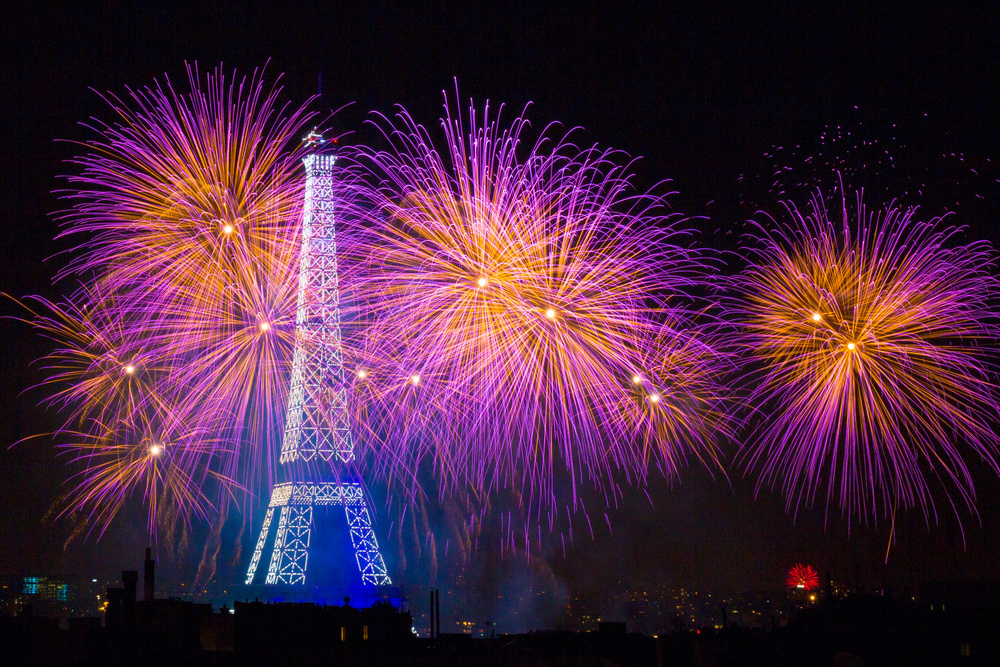A piece of fine art art photography titled Fireworks at the Eiffel Tower for the 14 July Celebration by Laurent Lothare Dambreville