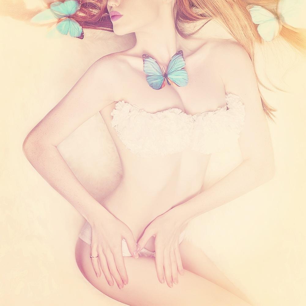 A piece of fine art art photography titled Butterfly Girl by Oren Hayman