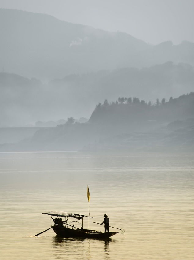 A piece of fine art art photography titled Fishing On Yangtze by Lev Tsimring