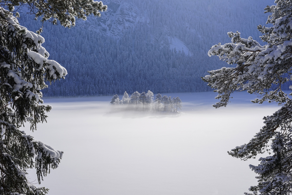 A piece of fine art art photography titled Fog Over Frozen Lake by Norbert Maier