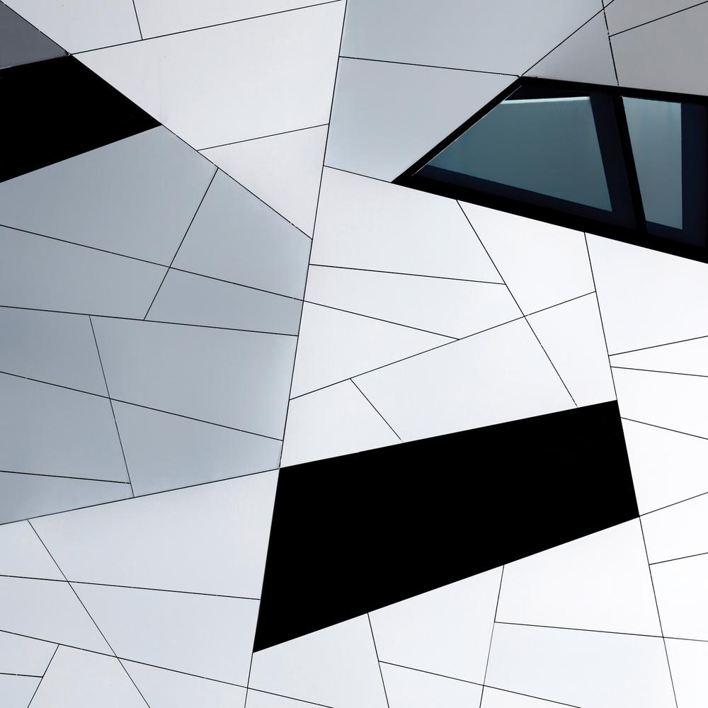 A piece of fine art art photography titled Facade Lines by Jeroen van de Wiel