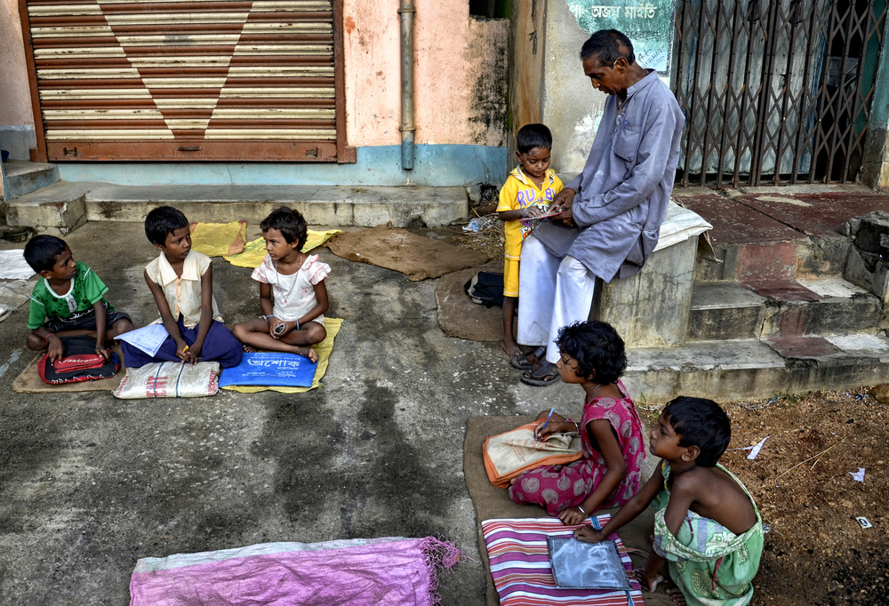 A piece of fine art art photography titled Street Education by Avishek Das