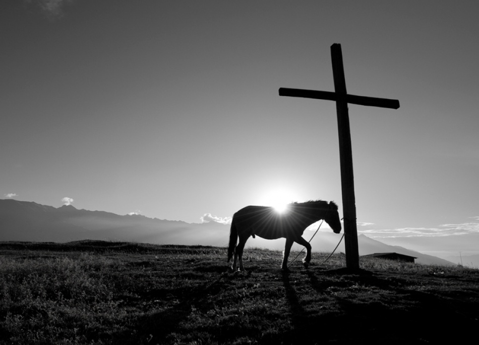 A piece of fine art art photography titled His Own Cross by Mihnea Turcu