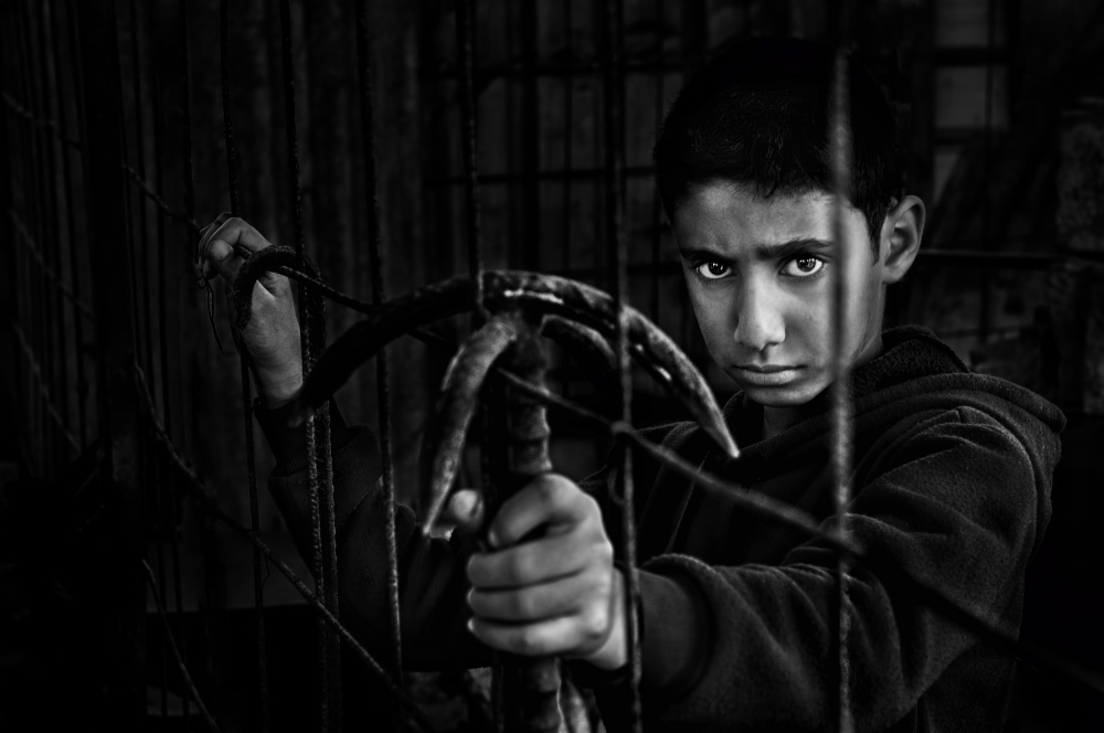A piece of fine art art photography titled Behind Bars by Saeed Dhahi