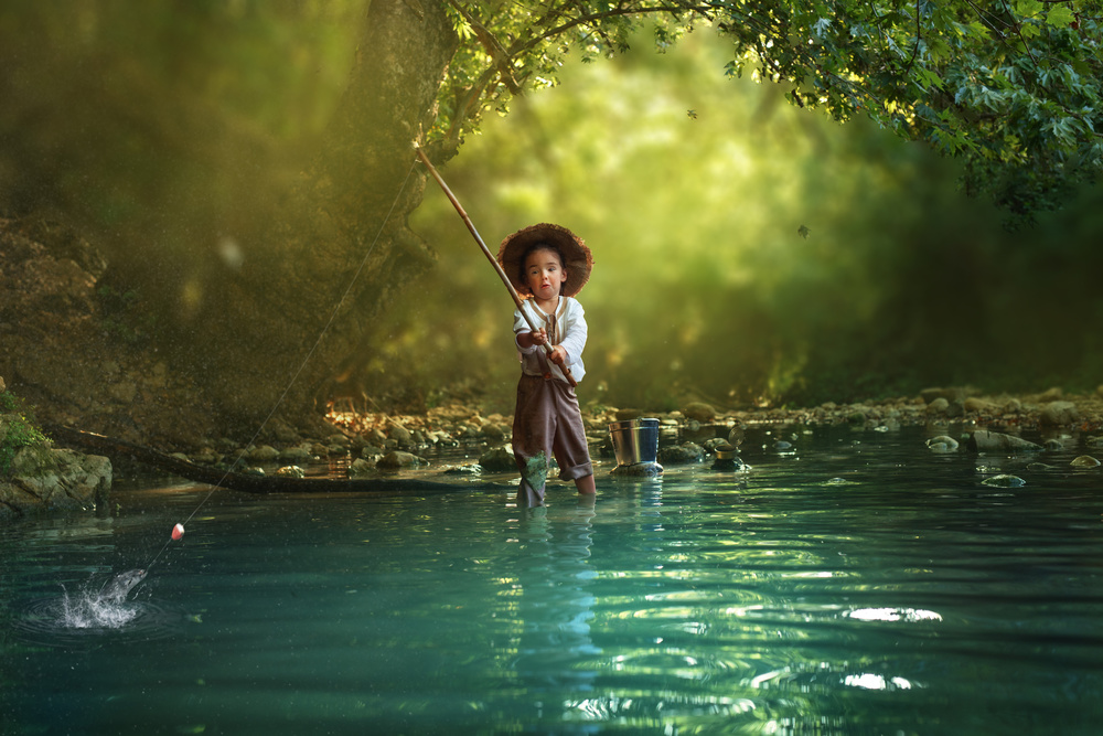 A piece of fine art art photography titled Fishing by Evgeny Loza