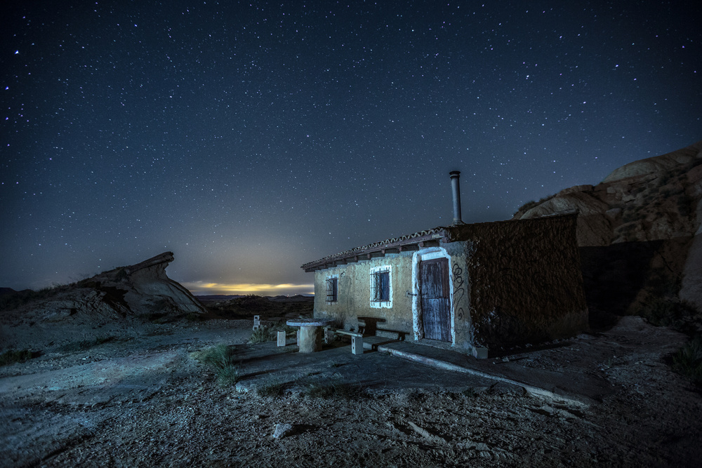 A piece of fine art art photography titled Bardenas Reales - Nightscape I - Tripa's Cabin by Jose Javier Duro Jimenez