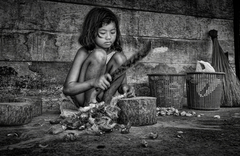 A piece of fine art art photography titled Areca Nut Splitting by SUPRATIKNO