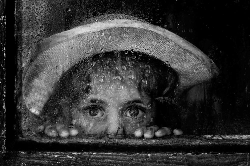 A piece of fine art art photography titled Rain by Ummu Nisan Kandilcioglu