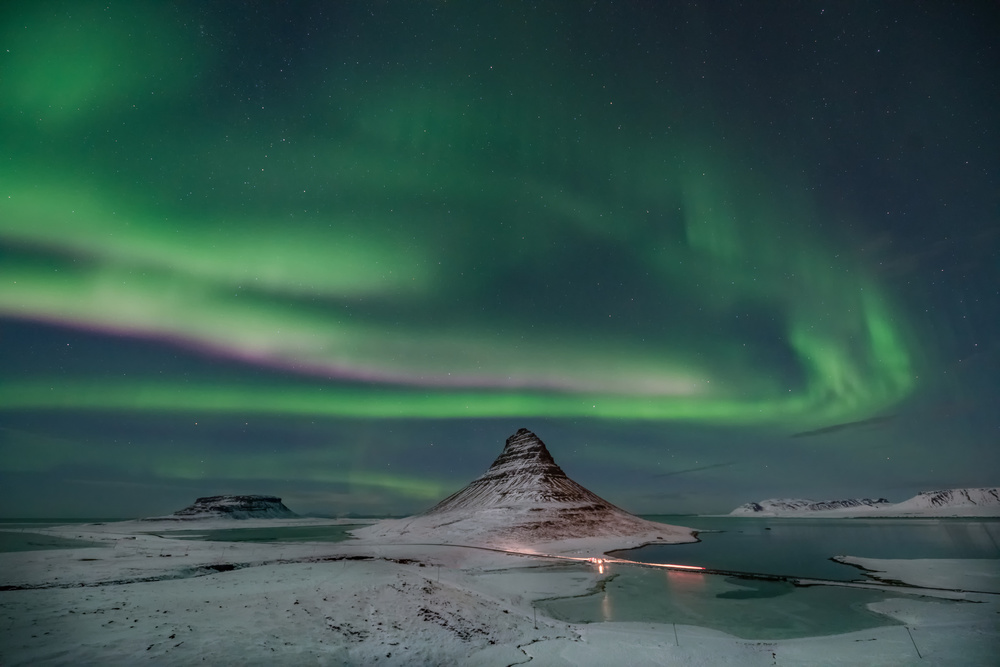 A piece of fine art art photography titled Aurora Borealis Over Kirkjufell by April Xie