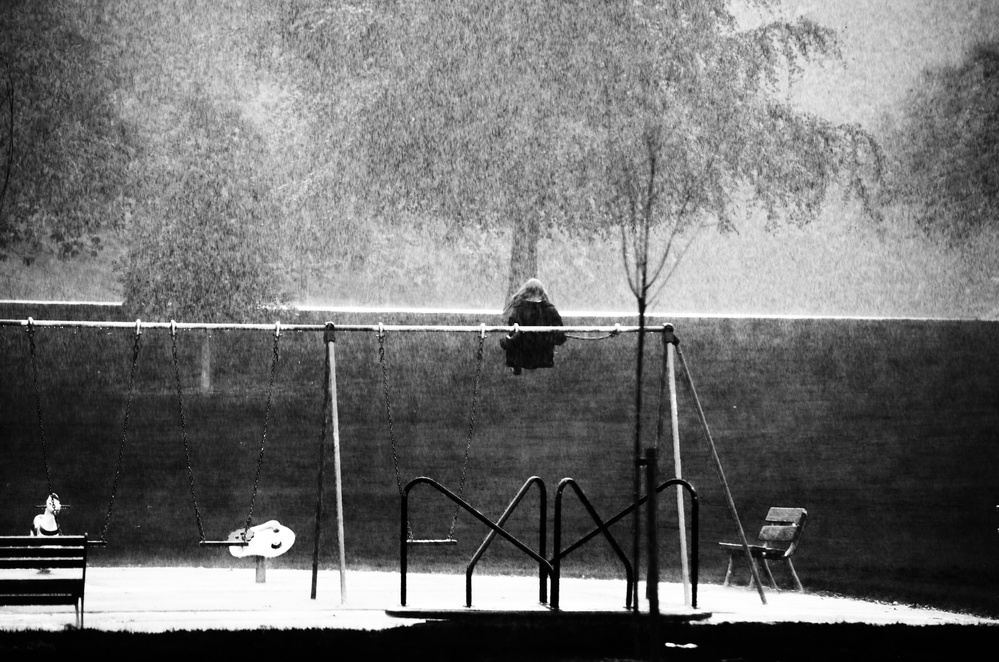 A piece of fine art art photography titled The Girl In the Rain 2 by ray clark