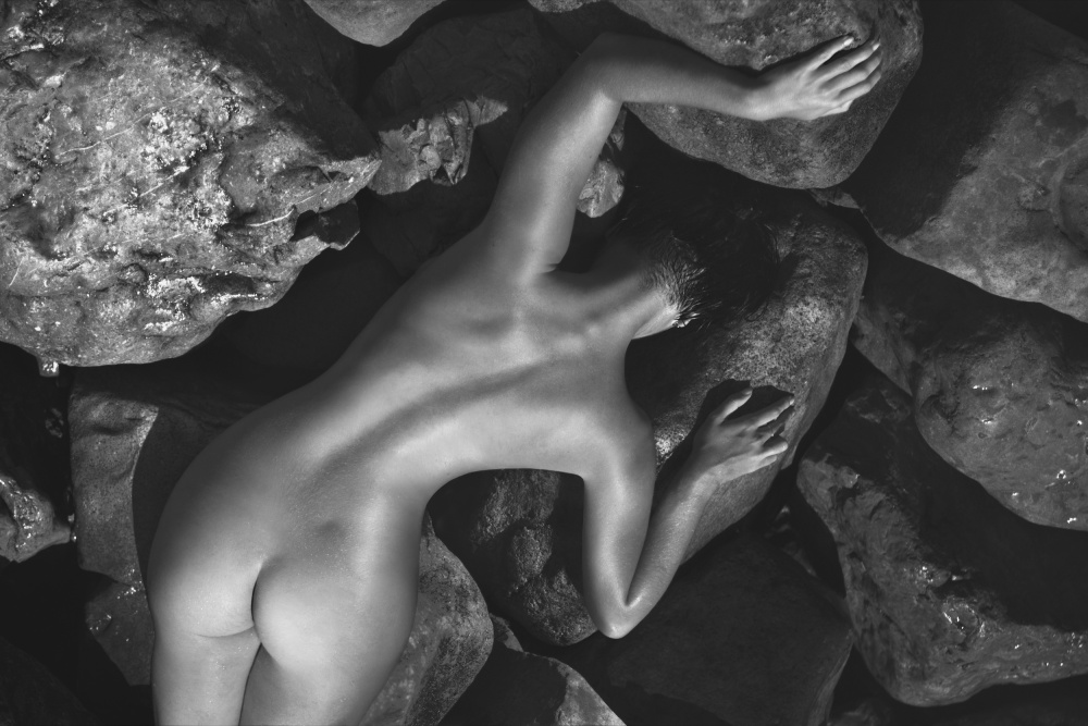 A piece of fine art art photography titled Between the Stones by Alexander Pereverzov