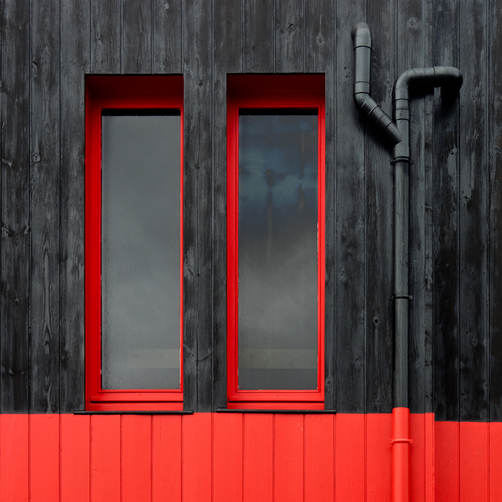 A piece of fine art art photography titled Red Windows by Jutta Kerber
