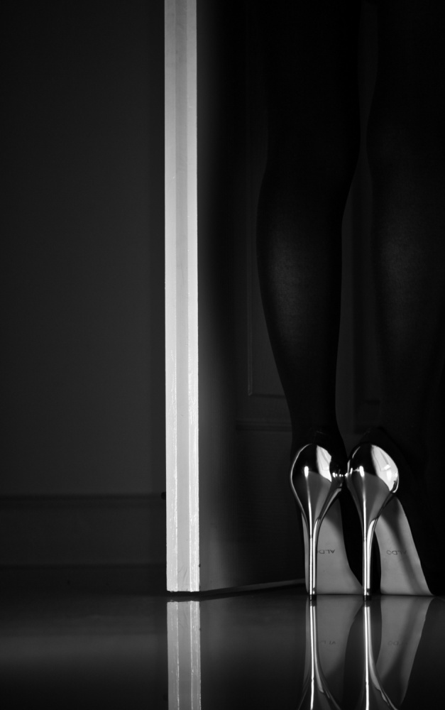 A piece of fine art art photography titled Black + White + Door by Erik Schottstaedt