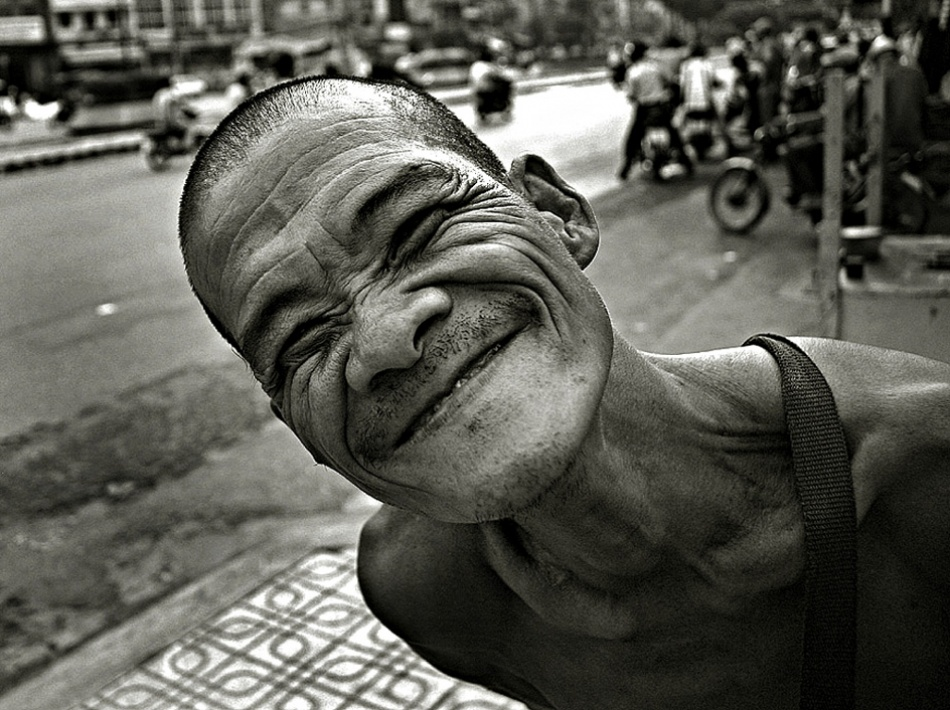 A piece of fine art art photography titled The Funny Lottery Seller by Helmut Schadt