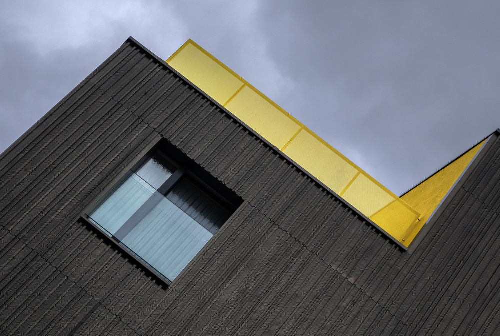 A piece of fine art art photography titled The Yellow Balcony by Jef Van den Houte