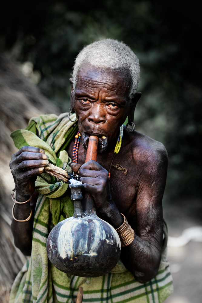 A piece of fine art art photography titled Lighting My Pipe by Trevor Cole