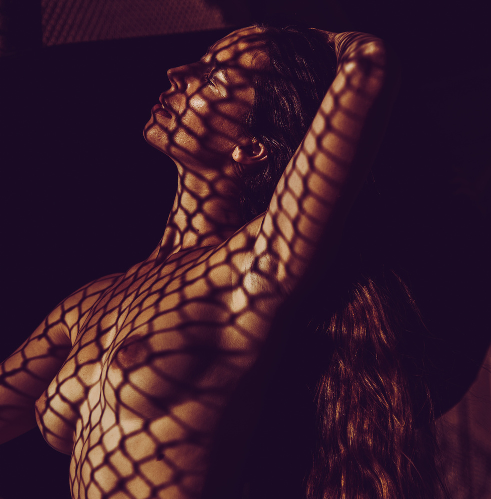 A piece of fine art art photography titled Spider Woman by Dov Amar