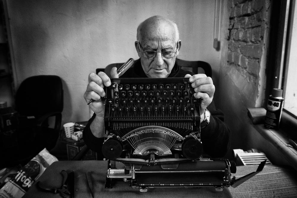 A piece of fine art art photography titled Typewriter Repairing by Mustafa Tiryakioglu