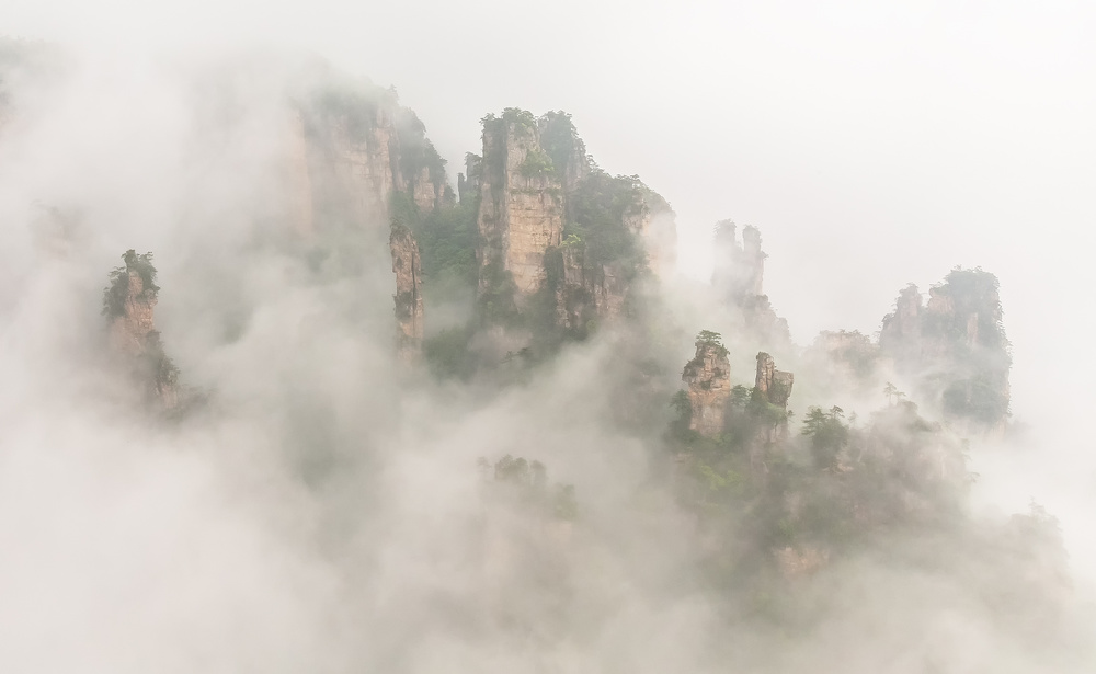 A piece of fine art art photography titled The Foggy Peaks by David Hua