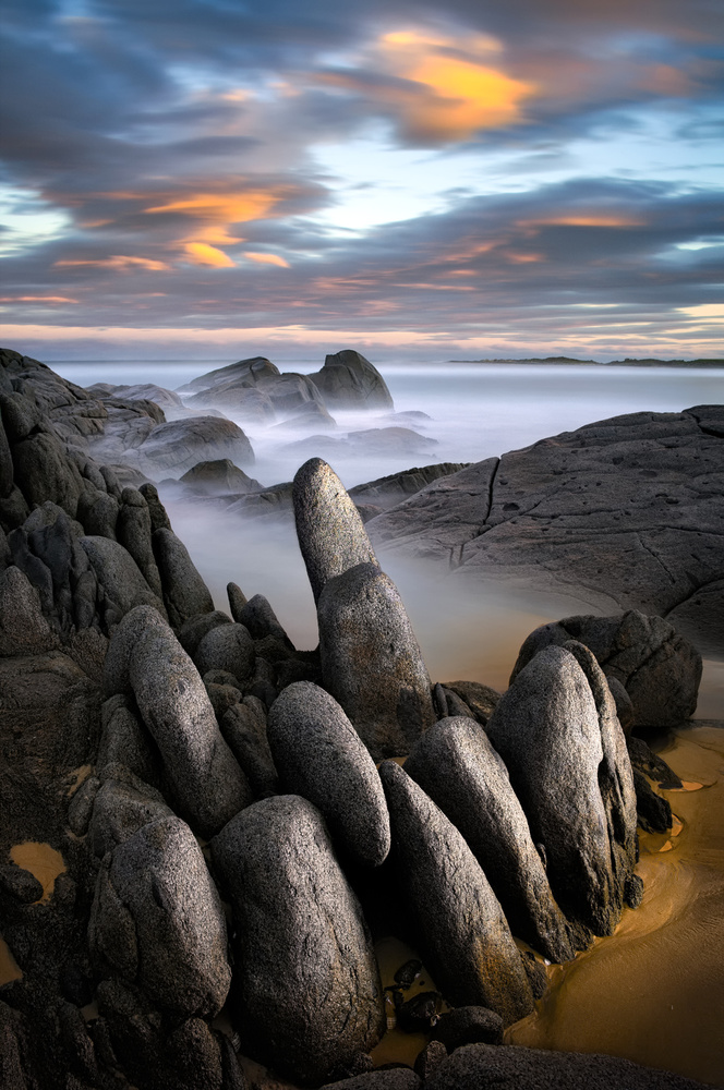 A piece of fine art art photography titled Stone Gathering - Grey Rocks by Francis Keogh