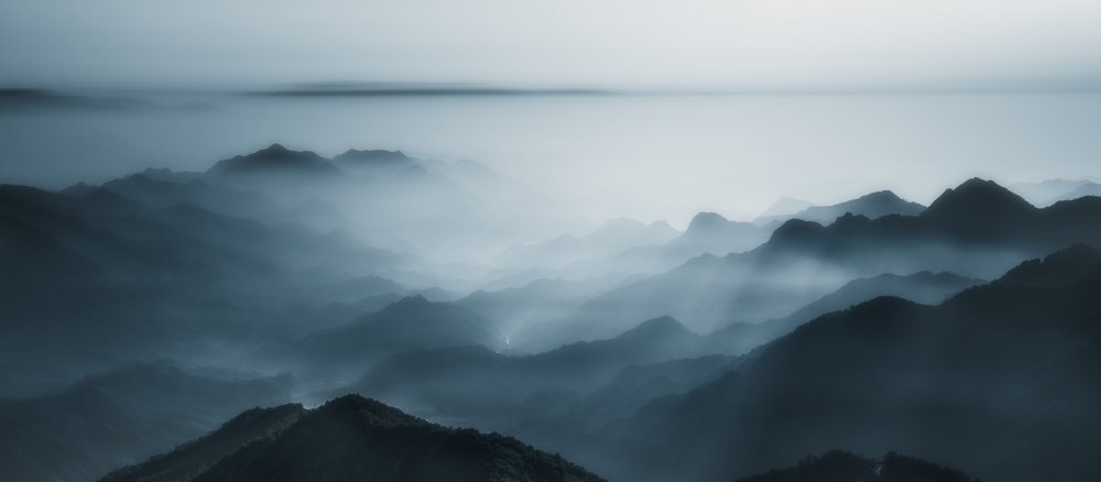 A piece of fine art art photography titled The Village In the Morning Mist by liwulei