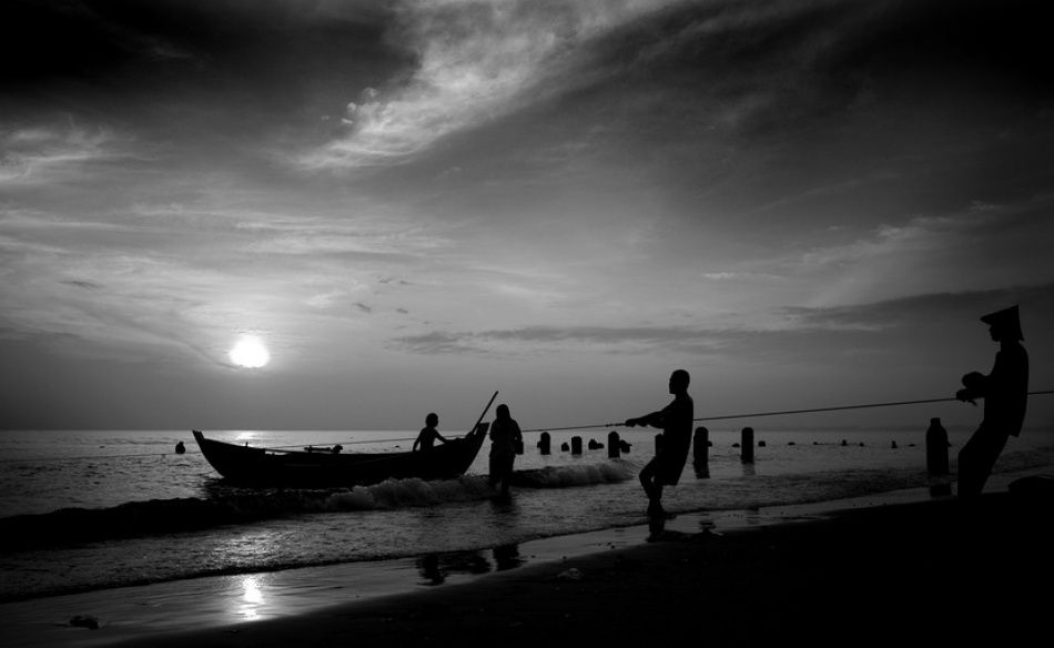 A piece of fine art art photography titled Fisherman by Agus Sarwono
