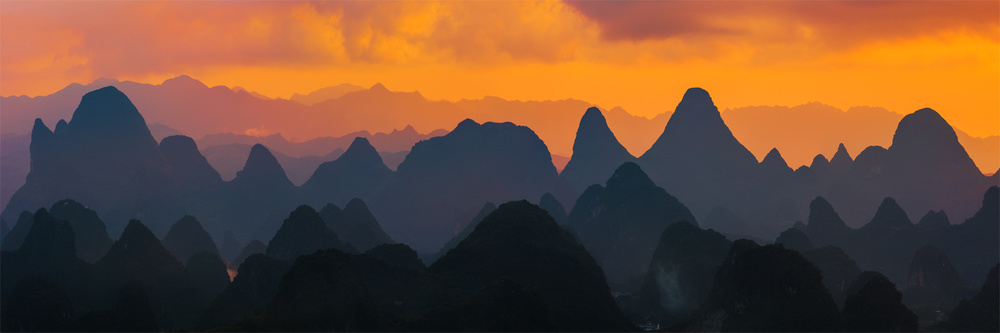 A piece of fine art art photography titled Painted Mountains by Yiming Hu