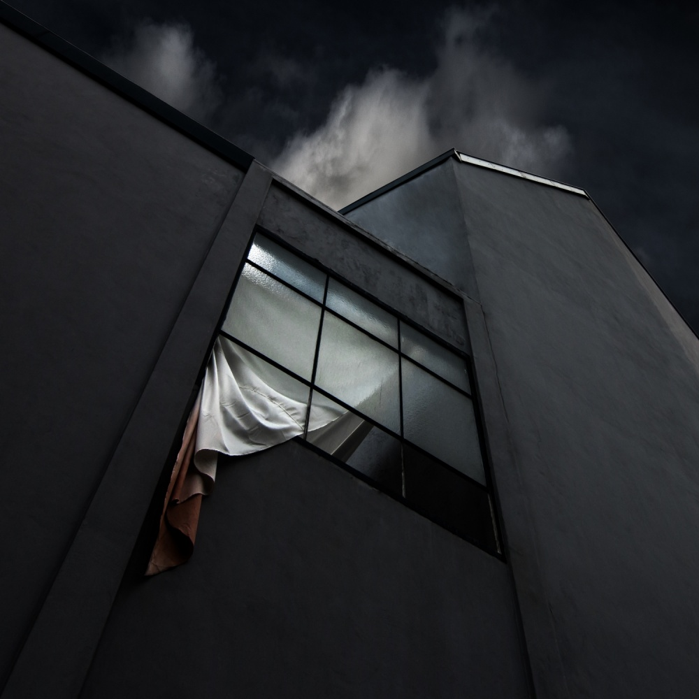 A piece of fine art art photography titled The Broken Window by Gilbert Claes