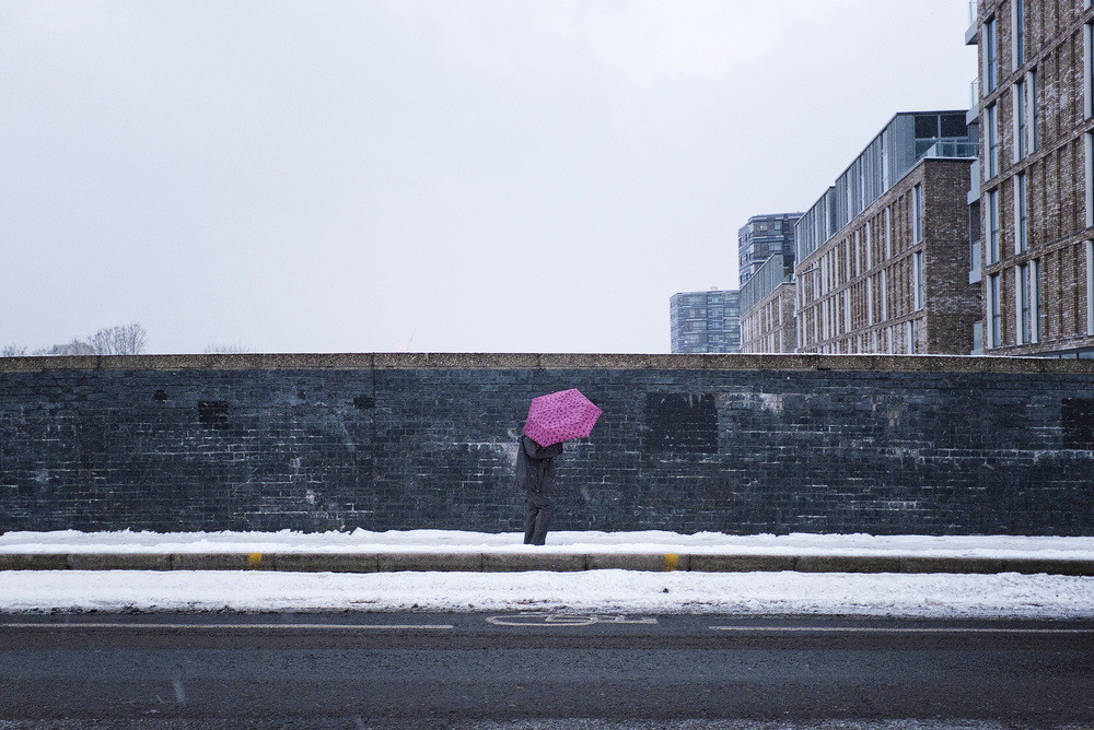 View this piece of fine art photography titled The pink umbrella by Lorenzo Grifantini