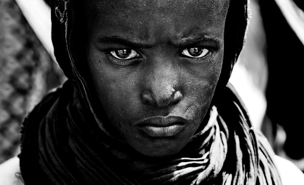 A piece of fine art art photography titled Surma Tribe Boy - Ethiopia by Joxe Inazio Kuesta Garmendia