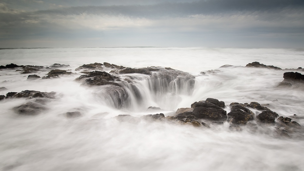 A piece of fine art art photography titled Thor's Well - Gateway to the Underworld by David Frey