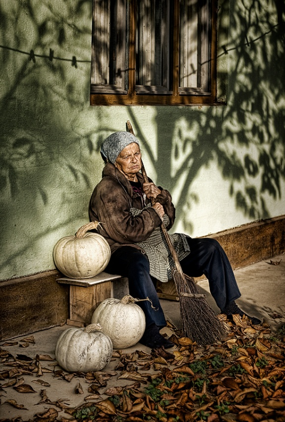 Old woman with pumpkins
