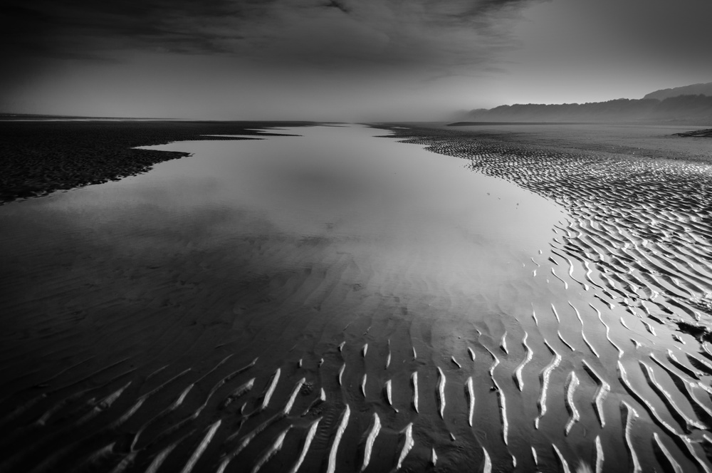 A piece of fine art art photography titled Fog On the Shore by Eddy Verloes