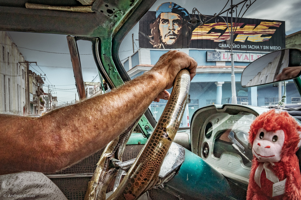 View this piece of fine art photography titled Che and the Taxidriver by Andreas Bauer