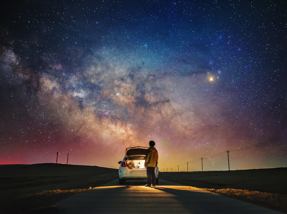A piece of fine art art photography titled The Cosmic Road Trip by Haitong Yu