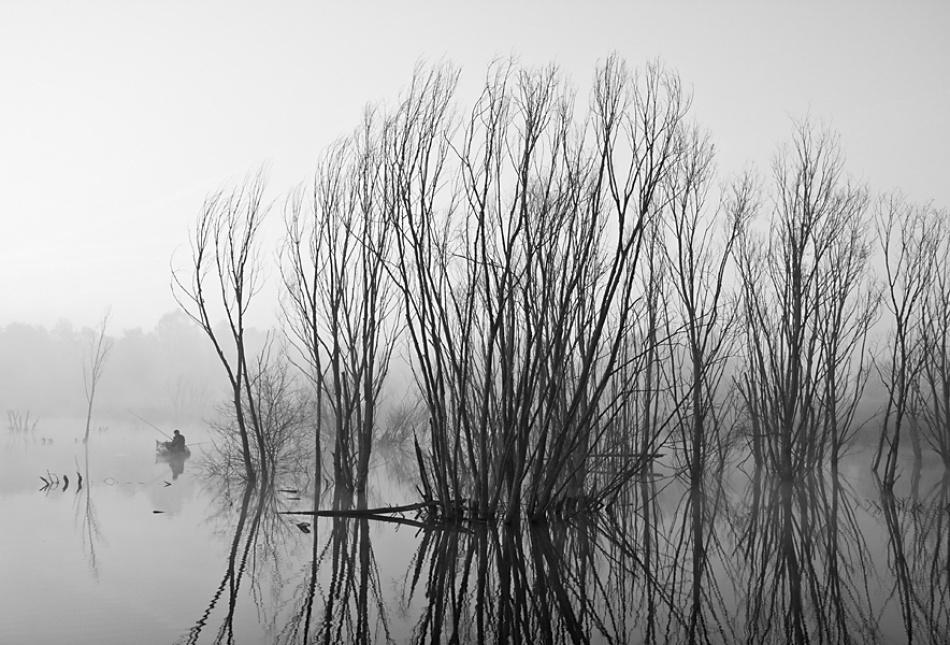A piece of fine art art photography titled The Fisherman by piotr kasprzyk