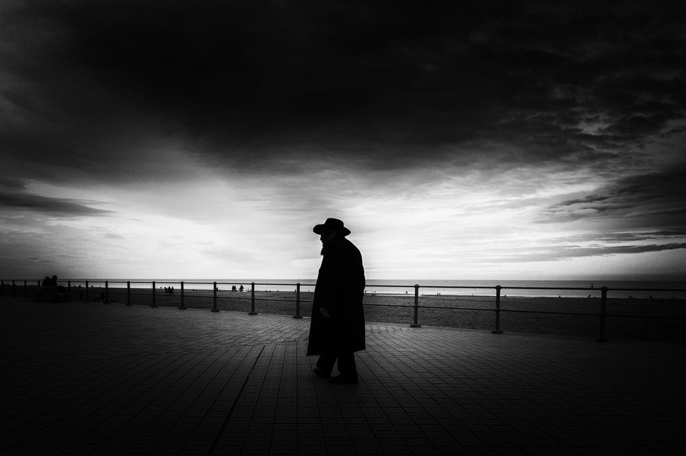 A piece of fine art art photography titled Stranger With Hat by Eddy Verloes