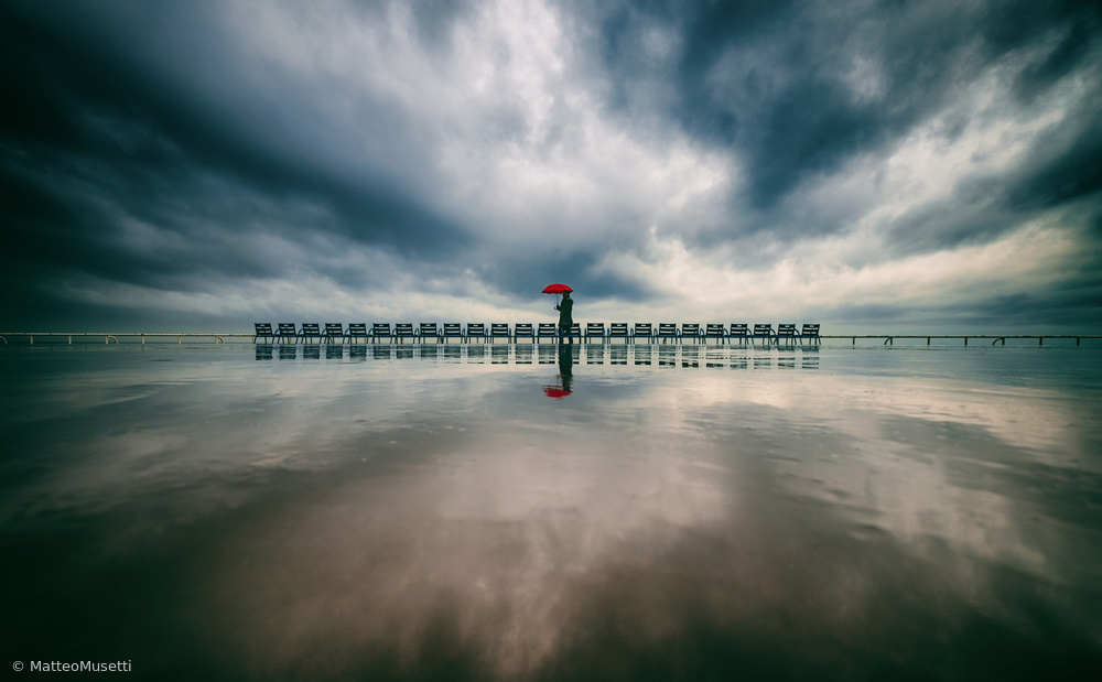 View this piece of fine art photography titled walking in the rain by Matteo Musetti