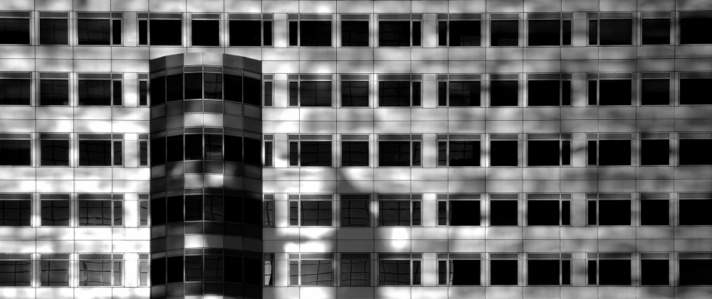 A piece of fine art art photography titled Morninglight Over the Office! by Huib Limberg