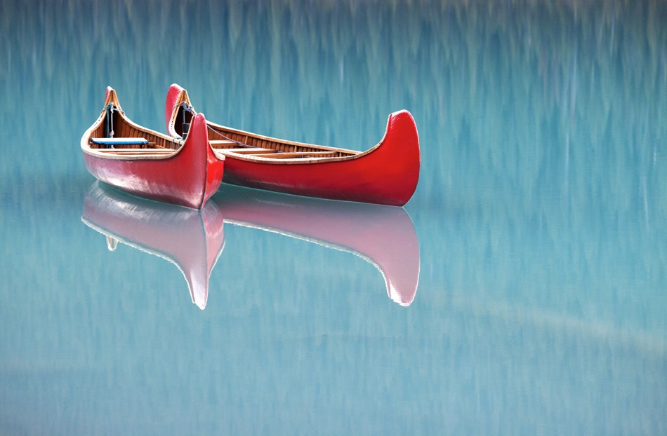 A piece of fine art art photography titled Les Canoes Rouges by nicolas schneider