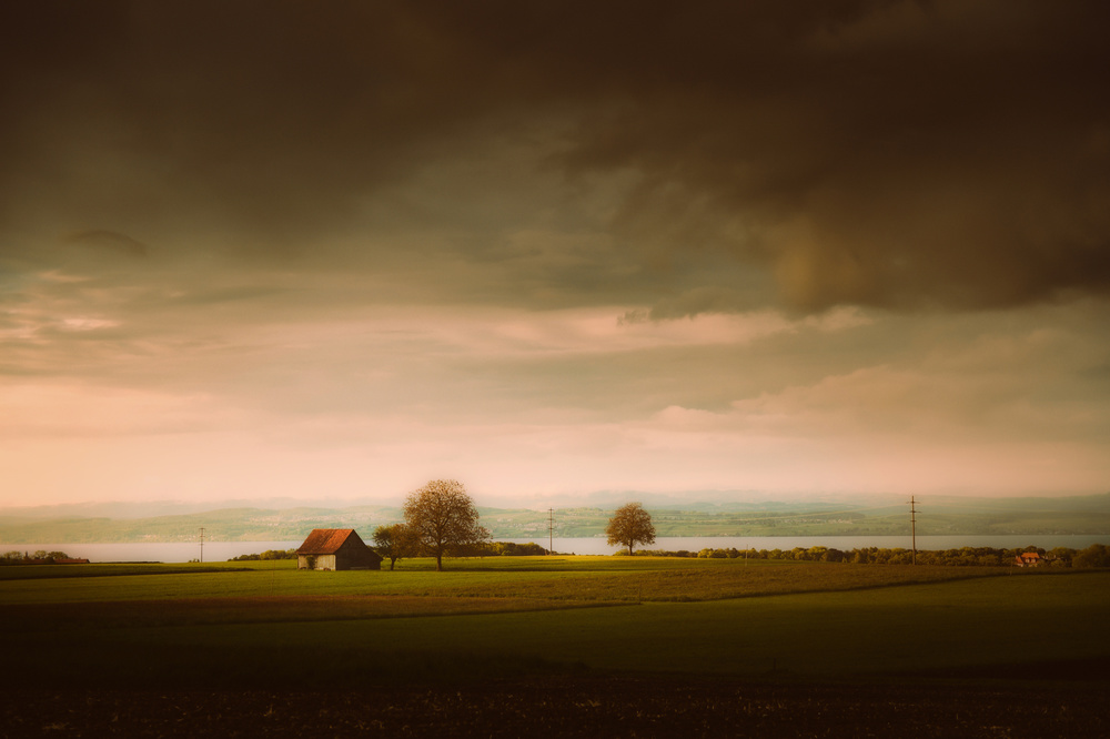 *** Dark Clouds and warm light over Lake Constance ***