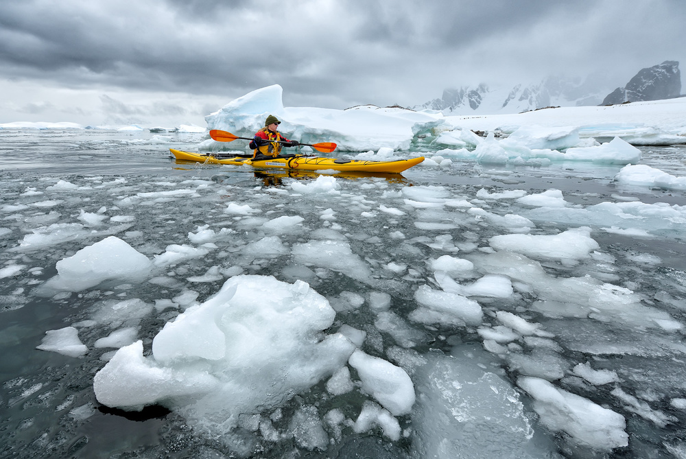 A piece of fine art art photography titled Antarctic Kayaking by Marsel van Oosten