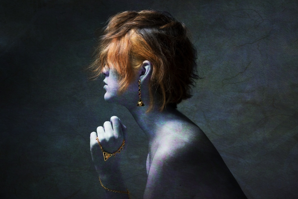 A piece of fine art art photography titled Talking In Riddles by Melissa Osorio