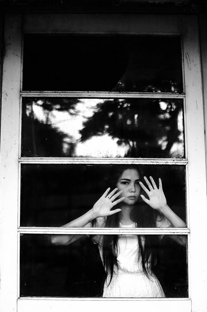A piece of fine art art photography titled Woman at Window by Riyan Aderia