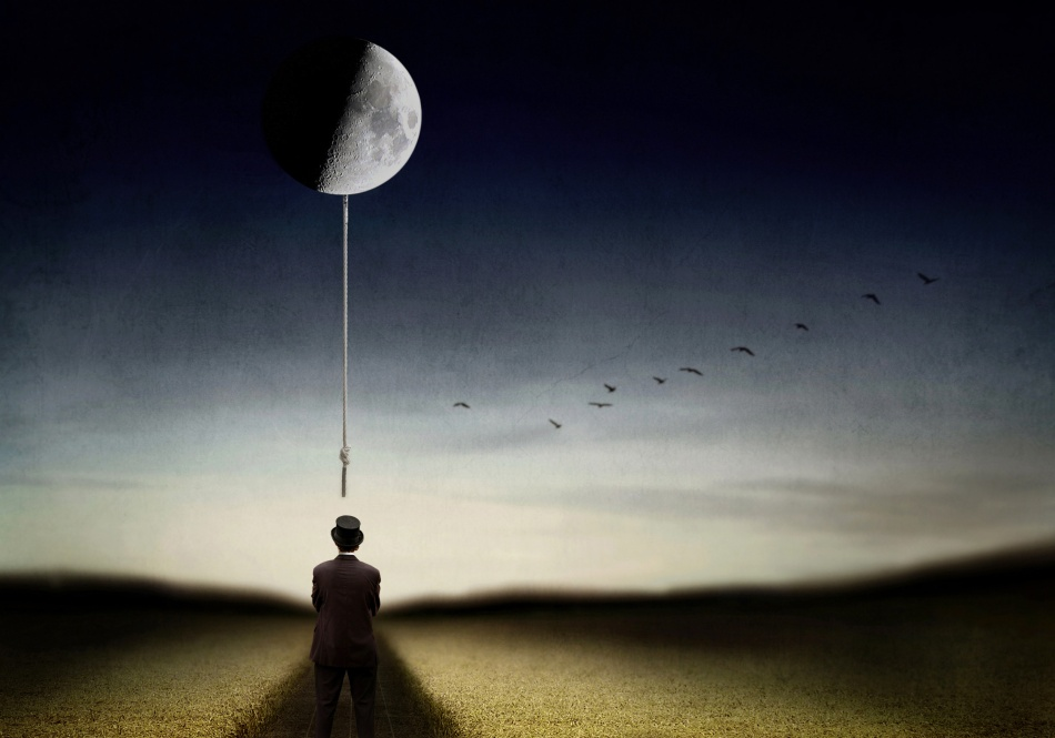 A piece of fine art art photography titled Man and the Moon by Ben Goossens